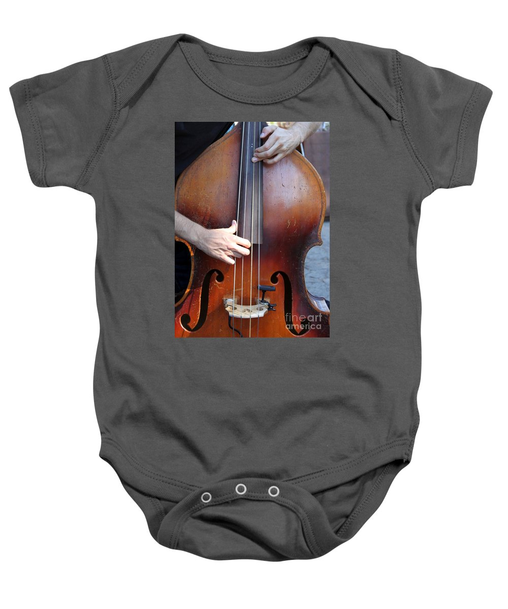 String Baby Onesie featuring the photograph Bass by Henrik Lehnerer