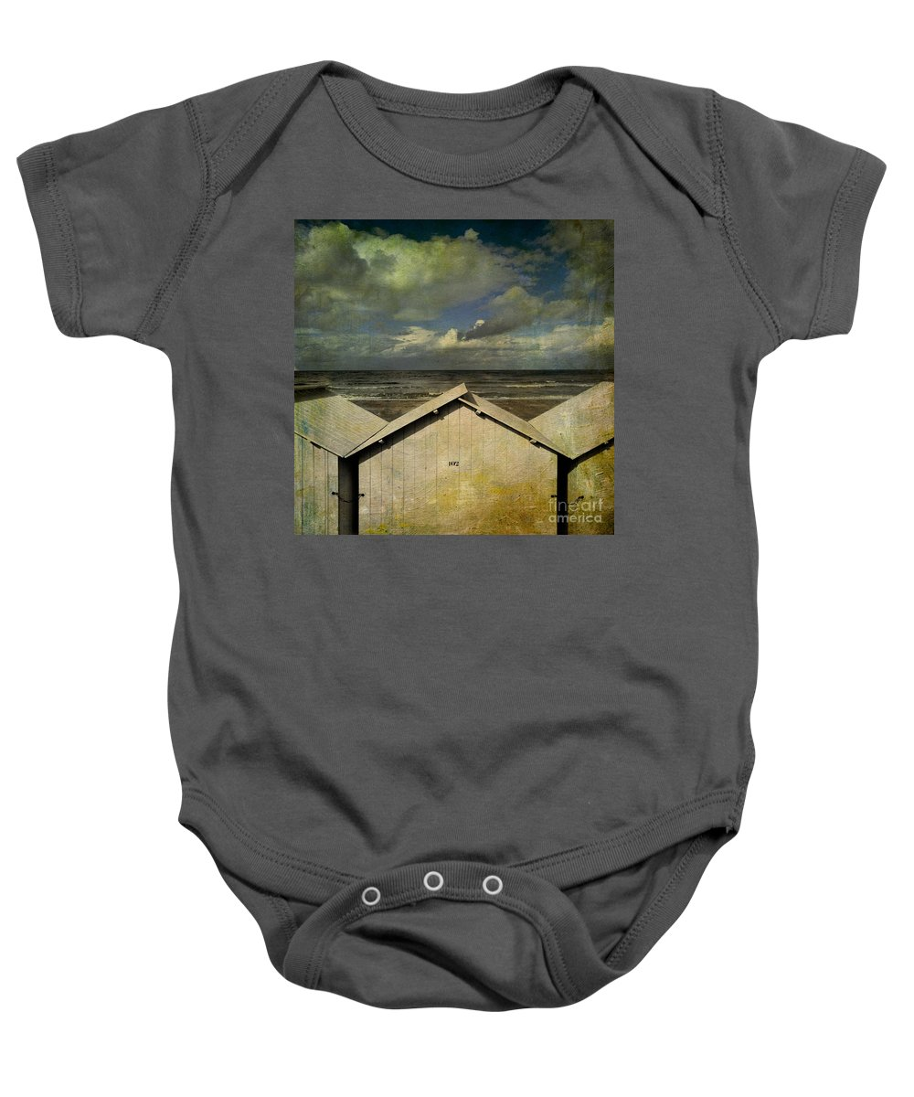 Yellowed Baby Onesie featuring the photograph Beach Huts Under A Stormy Sky. Vintage-look. Normandy. France by Bernard Jaubert