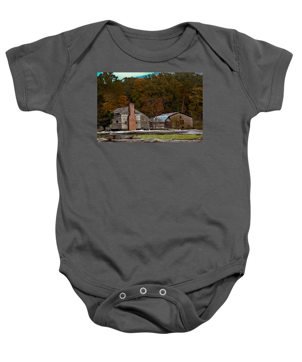 Settlement Baby Onesie featuring the photograph Beyond The Fence by DigiArt Diaries by Vicky B Fuller