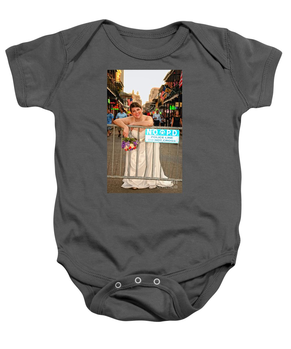Bride Baby Onesie featuring the photograph Bride And The Barricade On Bourbon Street by Kathleen K Parker