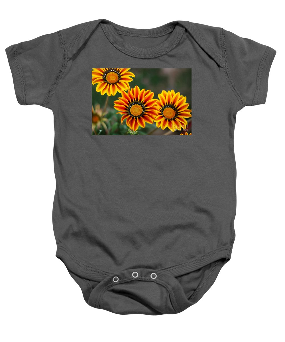 Flower Baby Onesie featuring the photograph Burning Hot by Syed Aqueel