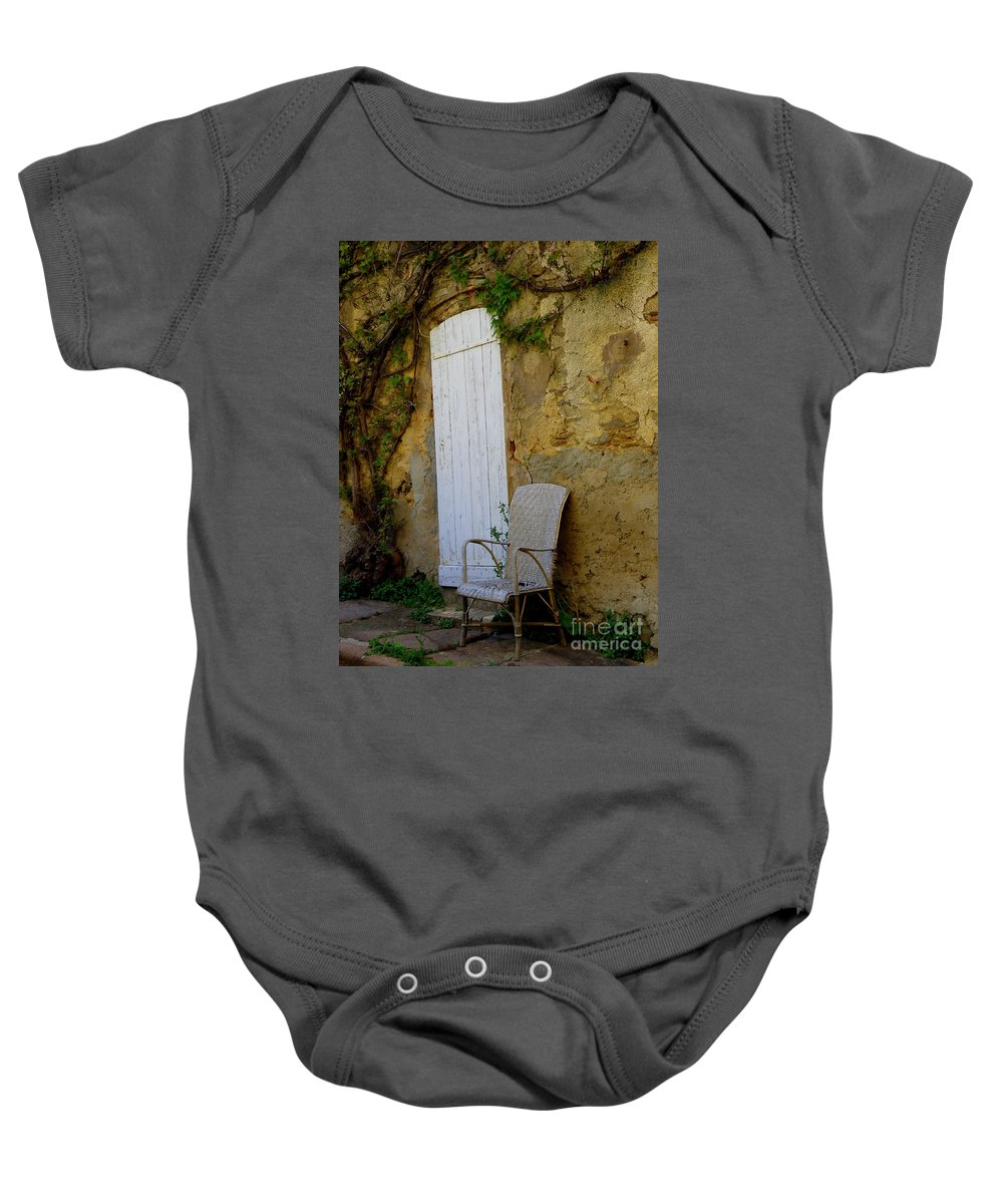 Door Baby Onesie featuring the photograph Chair By The White Door by Lainie Wrightson