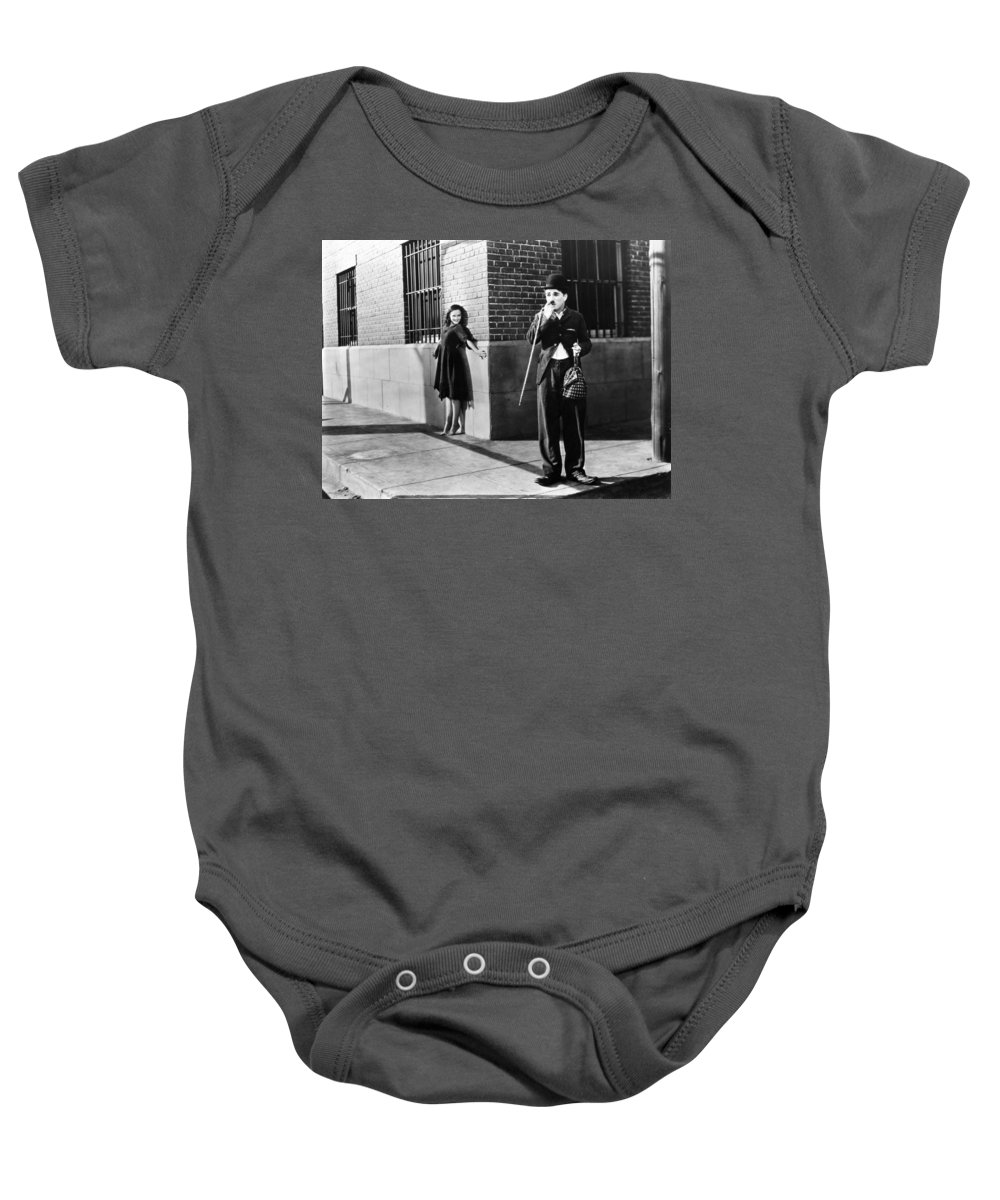 -nec04- Baby Onesie featuring the photograph Chaplin: Modern Times, 1936 by Granger