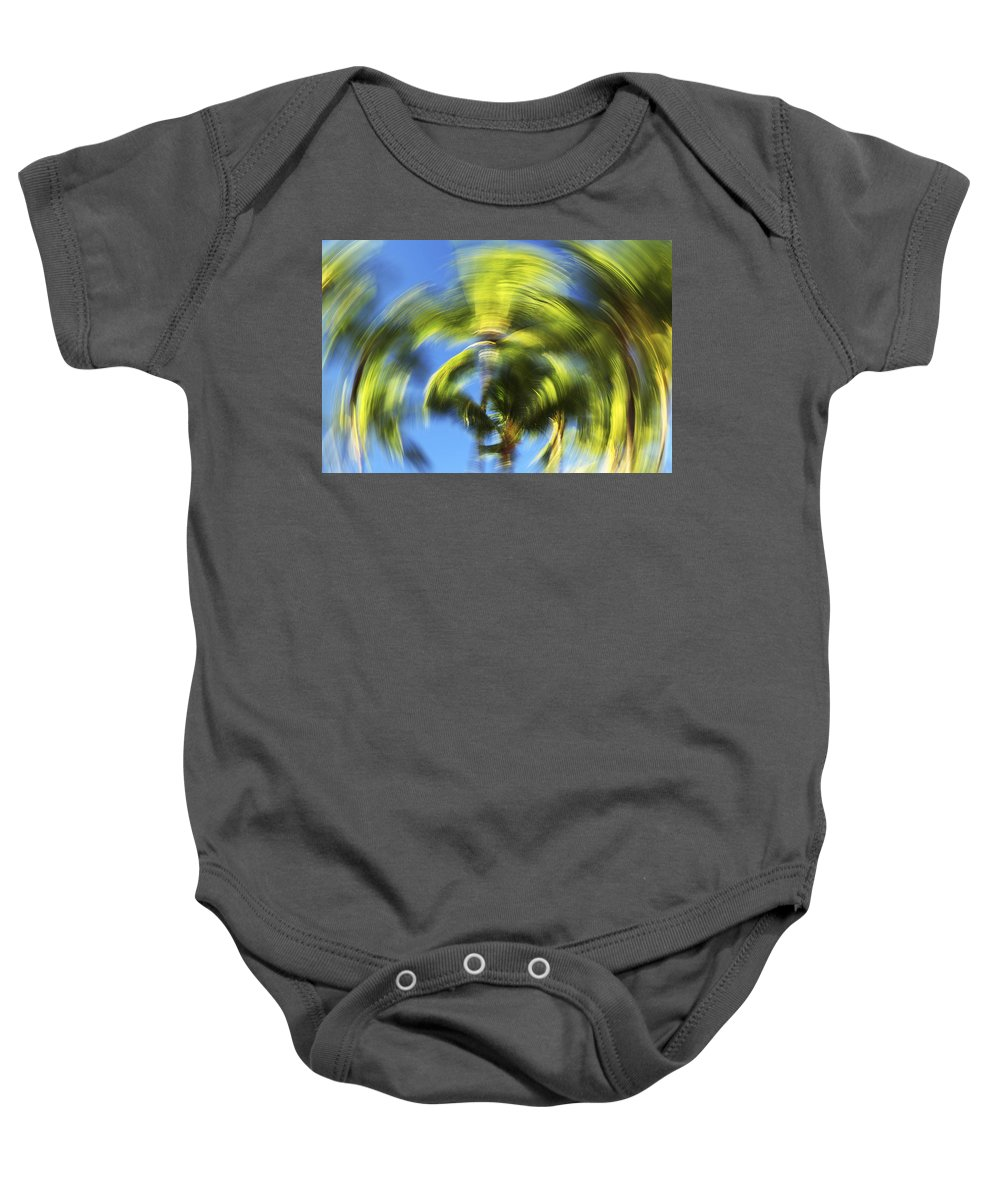 Abstract Baby Onesie featuring the photograph Circular Palm Blur by Vince Cavataio - Printscapes