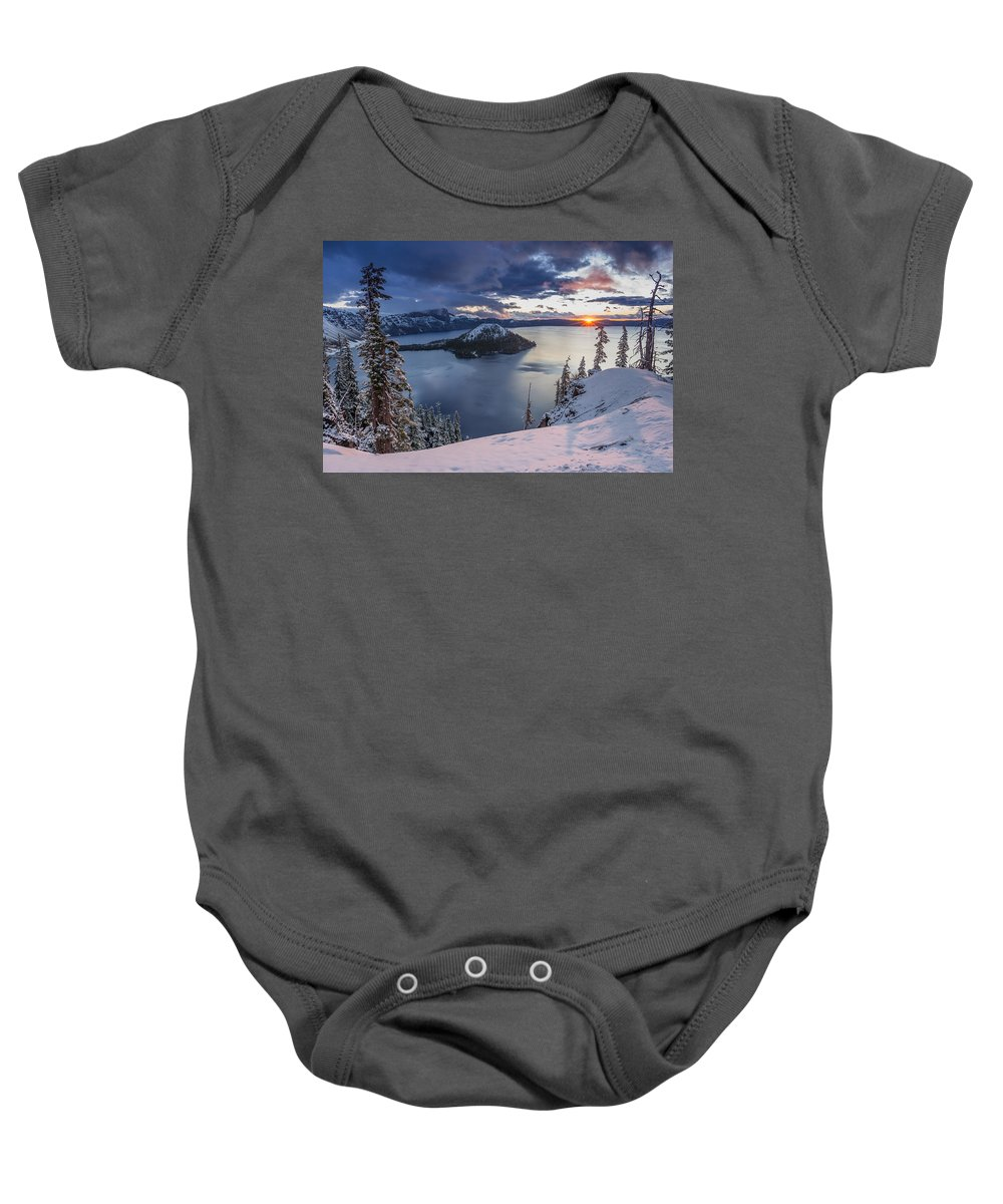 Crater Lake Baby Onesie featuring the photograph Crater Lake Snow Sunrise by Greg Nyquist
