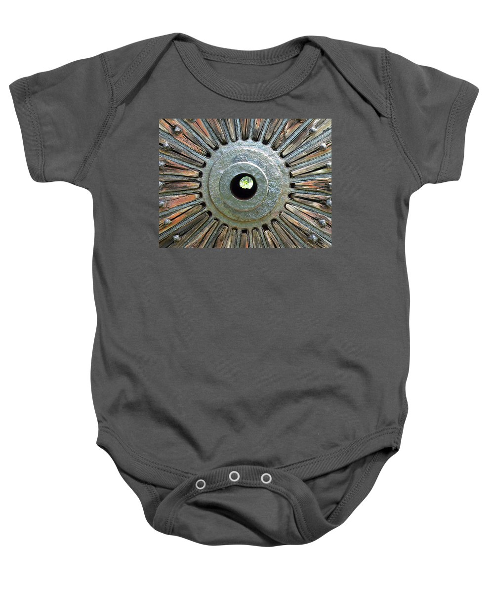 Deleon Springs Wheel Spoke Antique Old Baby Onesie featuring the photograph Deleon Springs Wheel Spoke by Alice Gipson