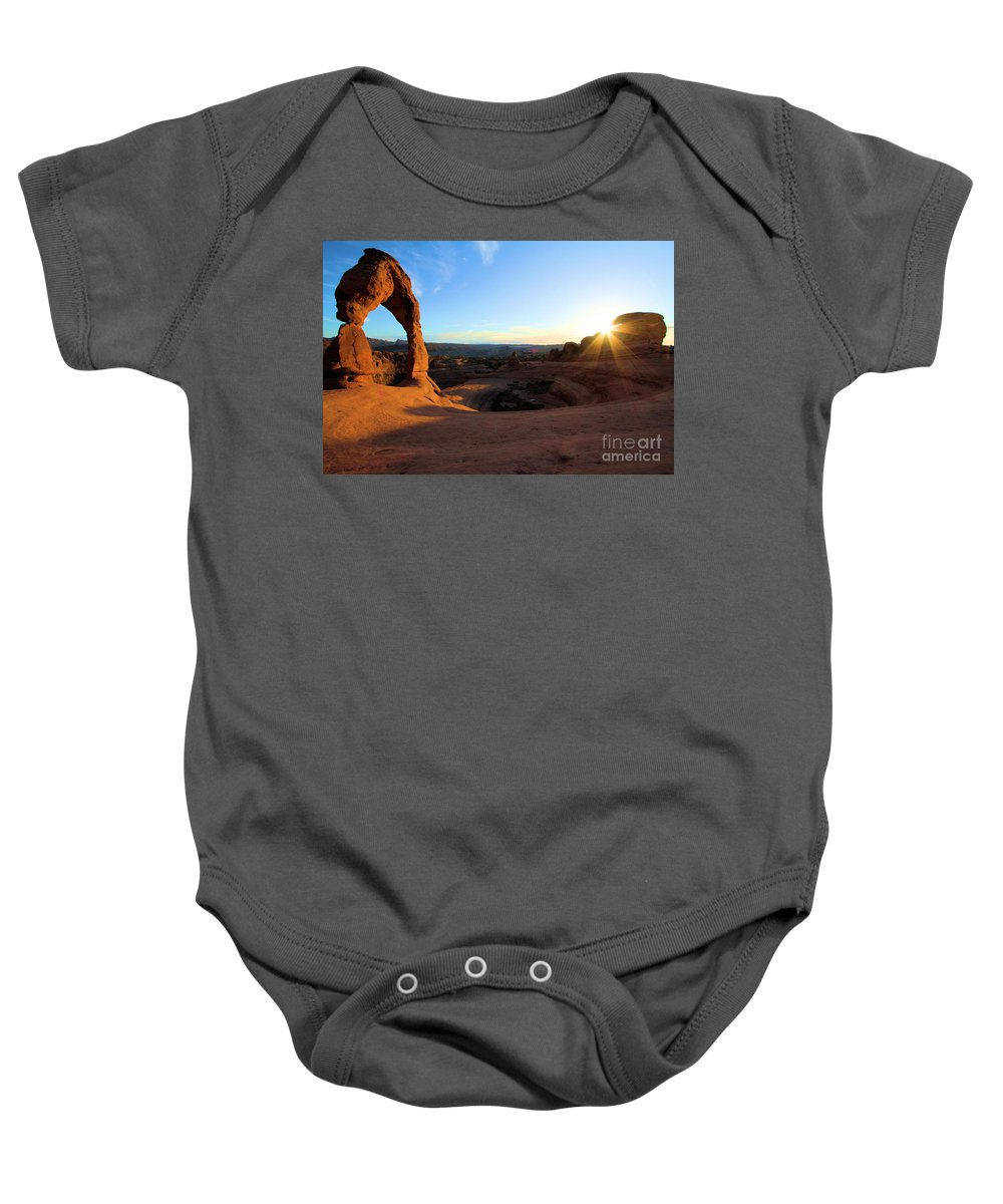 Delicate Arch Baby Onesie featuring the photograph Delicate Arch Bowl Starburst by Adam Jewell
