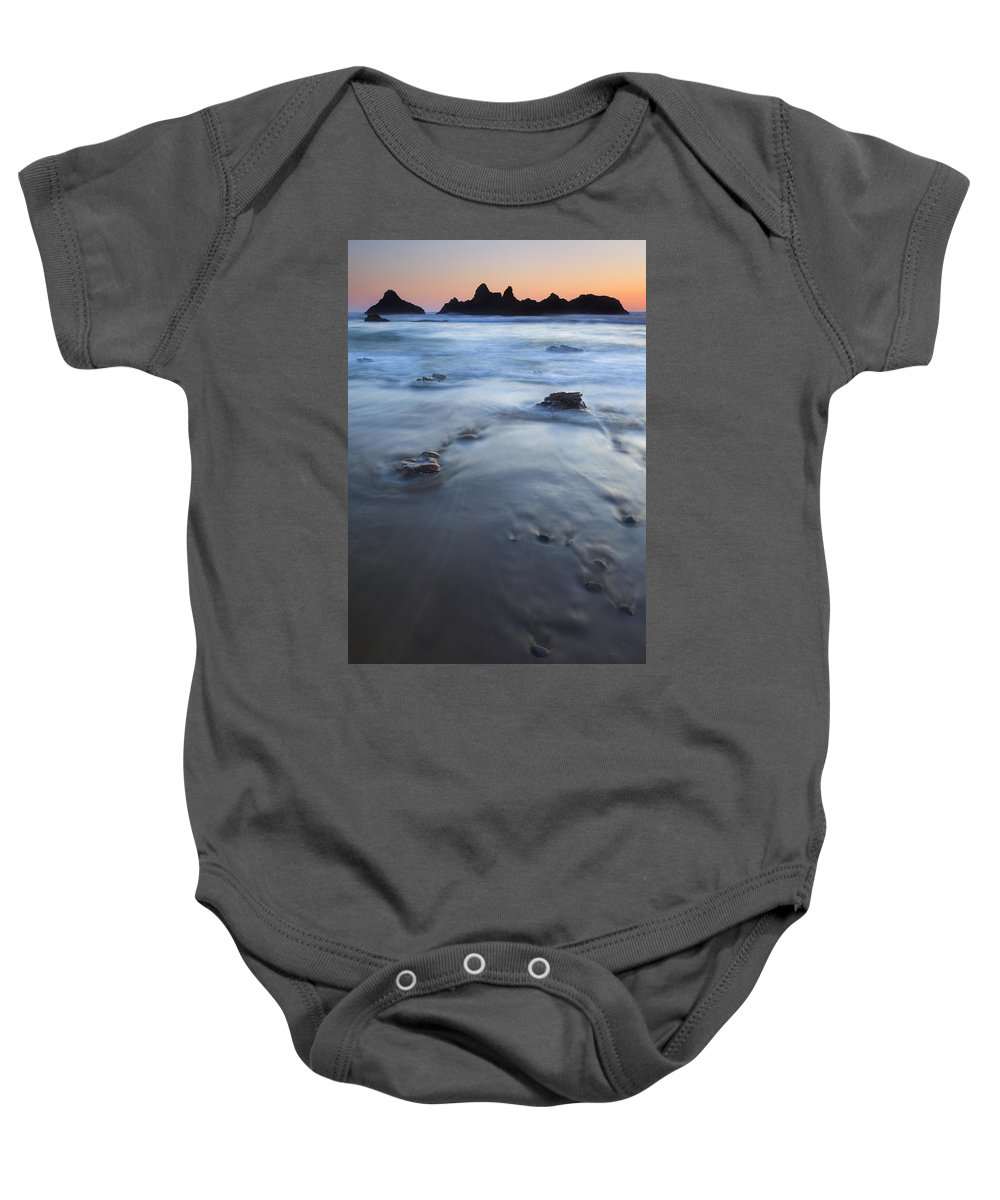 Seal Rock Baby Onesie featuring the photograph Ebb Stones by Mike Dawson