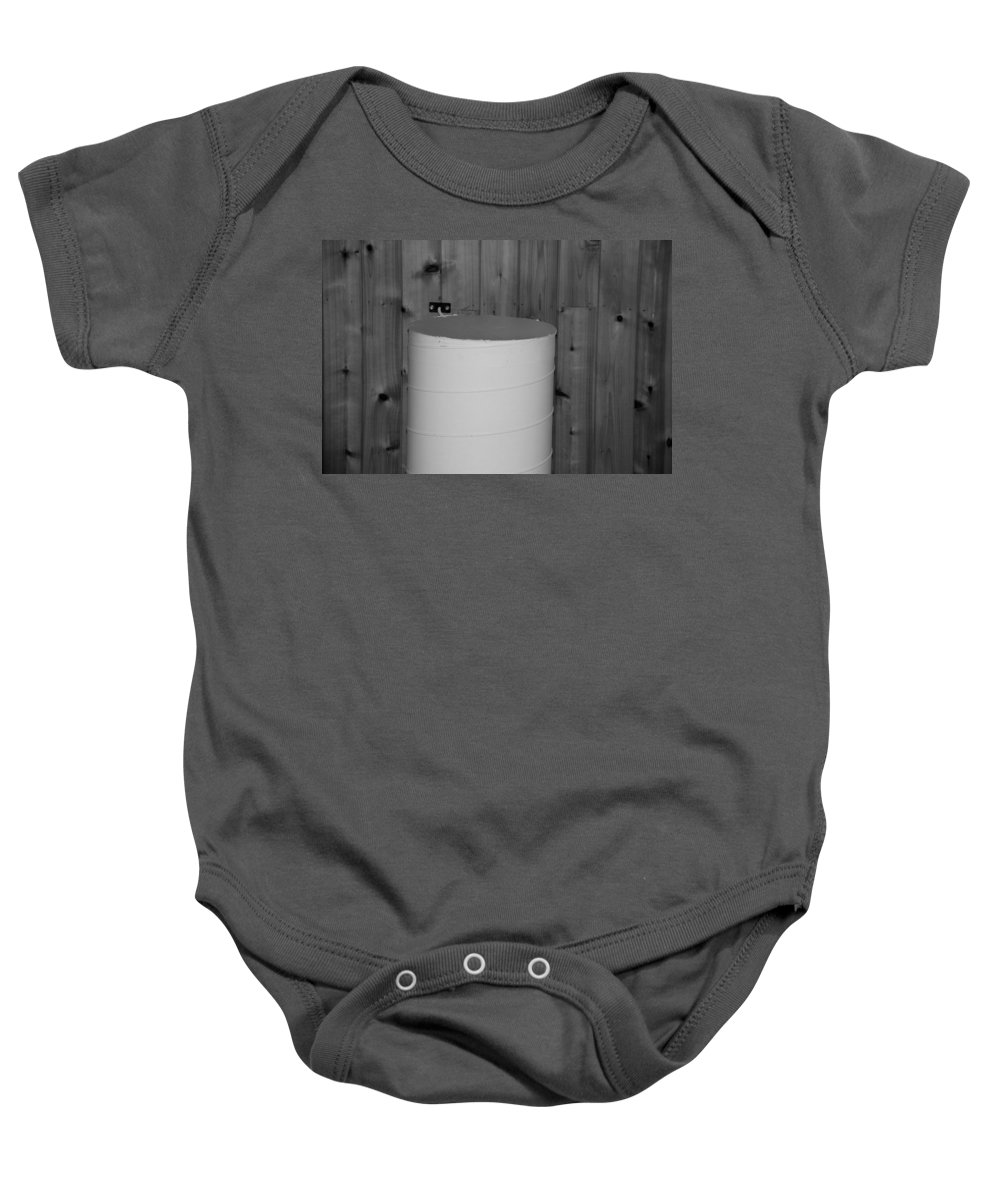 Black And White Baby Onesie featuring the photograph End Of The Pipe by Rob Hans