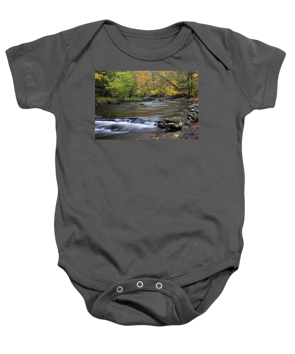 Fall Baby Onesie featuring the photograph Fall Forward by Jeff Bord