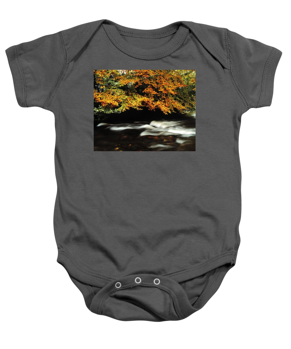 Fall Colors Baby Onesie featuring the photograph Fast Flowing Water And Fall Colours by The Irish Image Collection