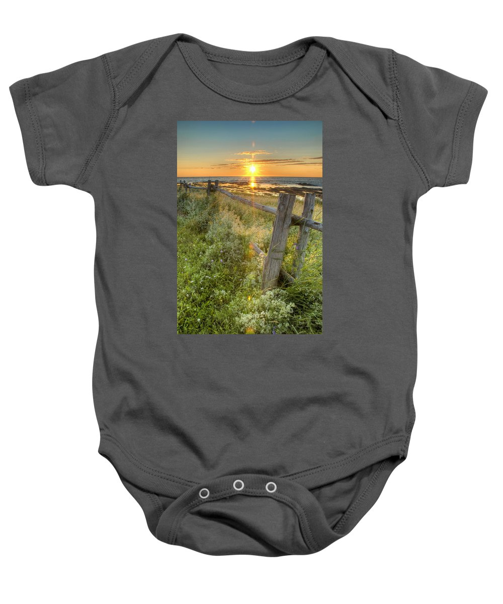 Blue Sky Baby Onesie featuring the photograph Fence Along The Shore by Philippe Widling