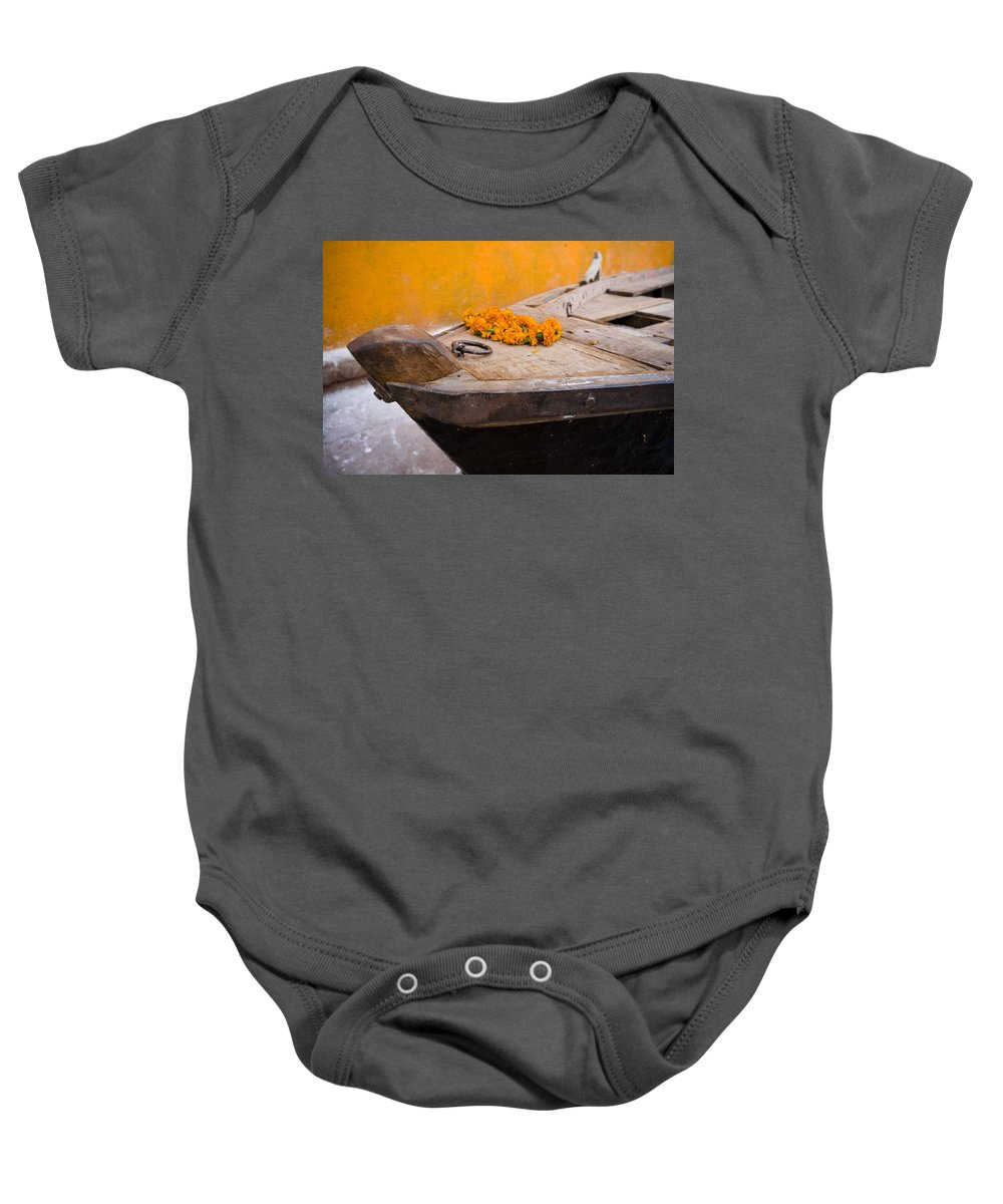 Canoe Baby Onesie featuring the photograph Flowers On Top Of Wooden Canoe by David DuChemin