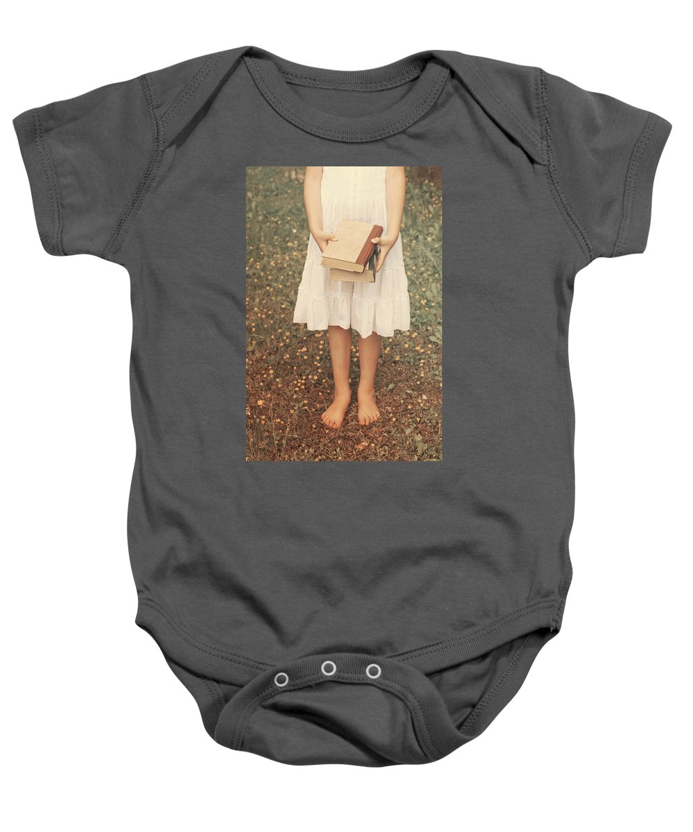Girl Baby Onesie featuring the photograph Girl With Old Books by Joana Kruse