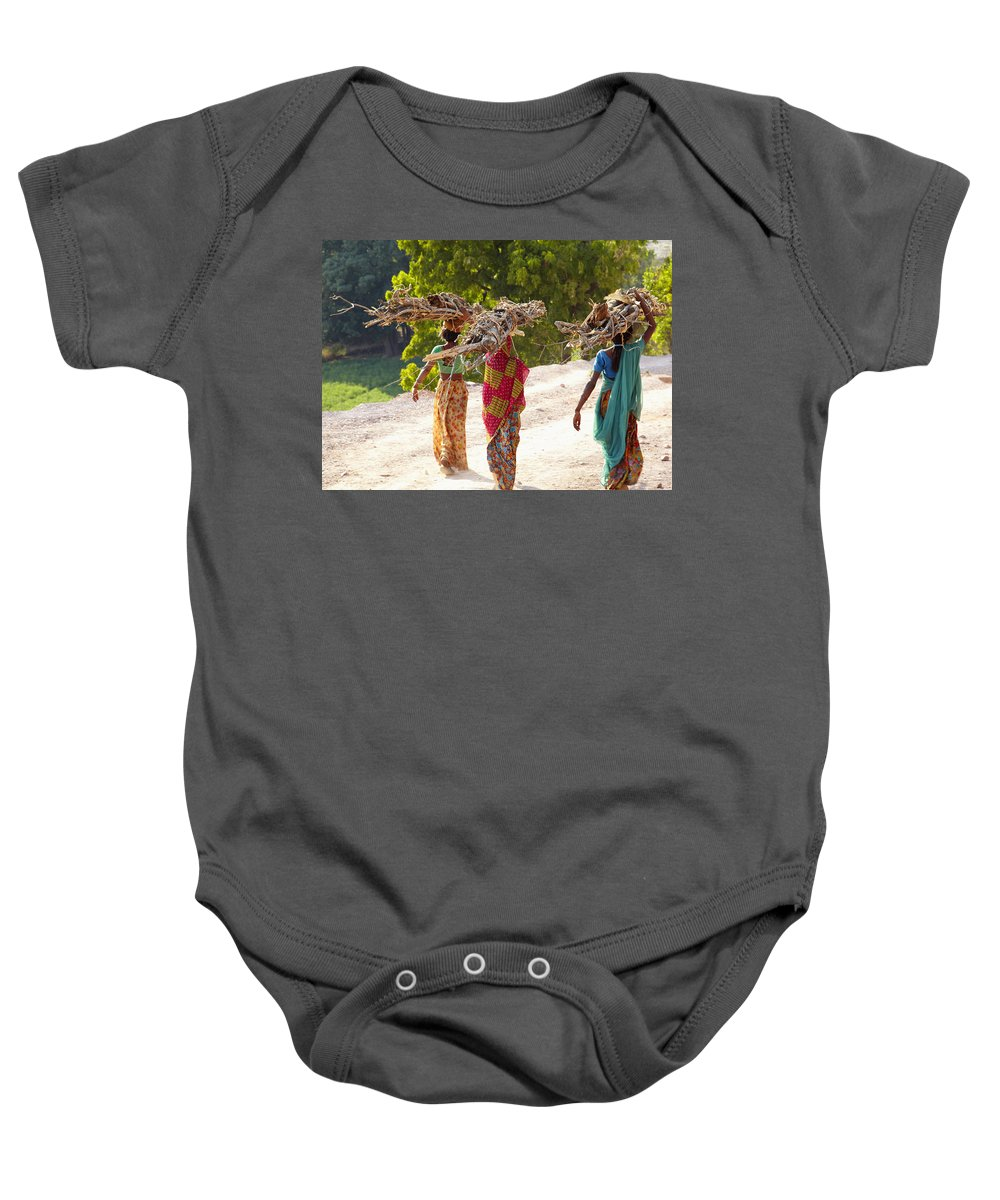 India! Indian Baby Onesie featuring the photograph Group Of Women Carrying Firewood Near by Axiom Photographic