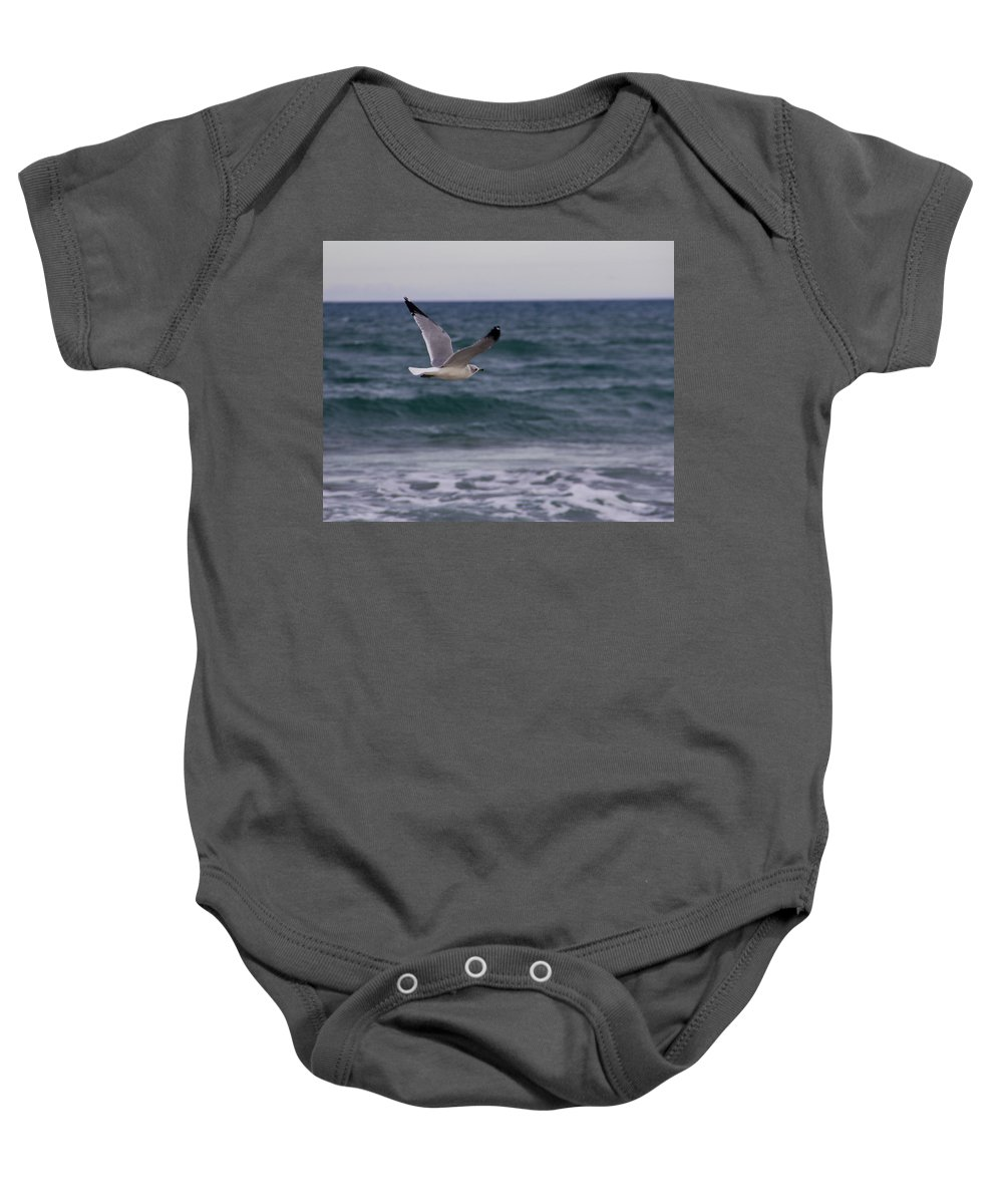 Ocean Baby Onesie featuring the photograph Gull In Flight by Roger Wedegis