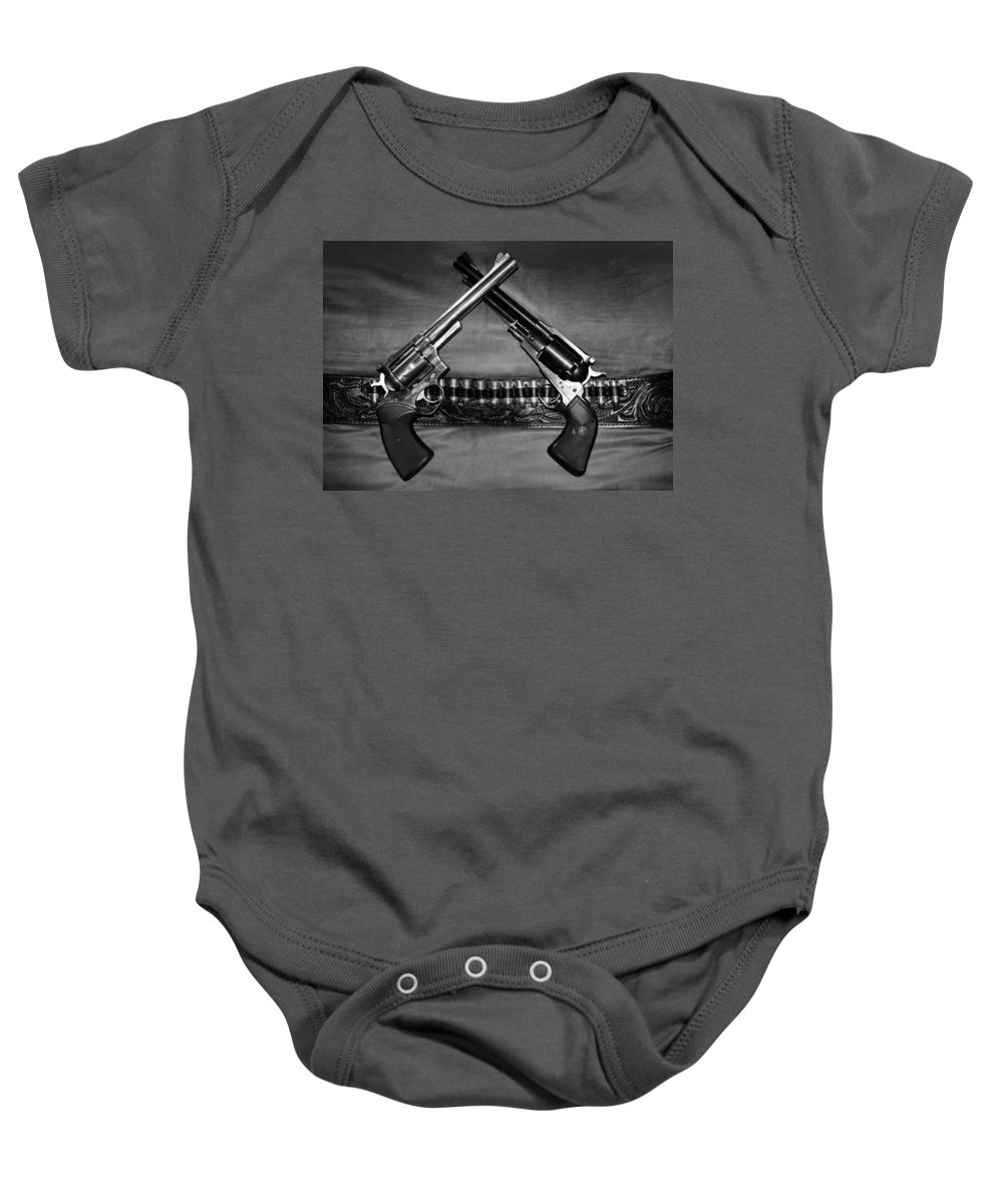 Guns Baby Onesie featuring the photograph Guns In Black And White by Kristin Elmquist