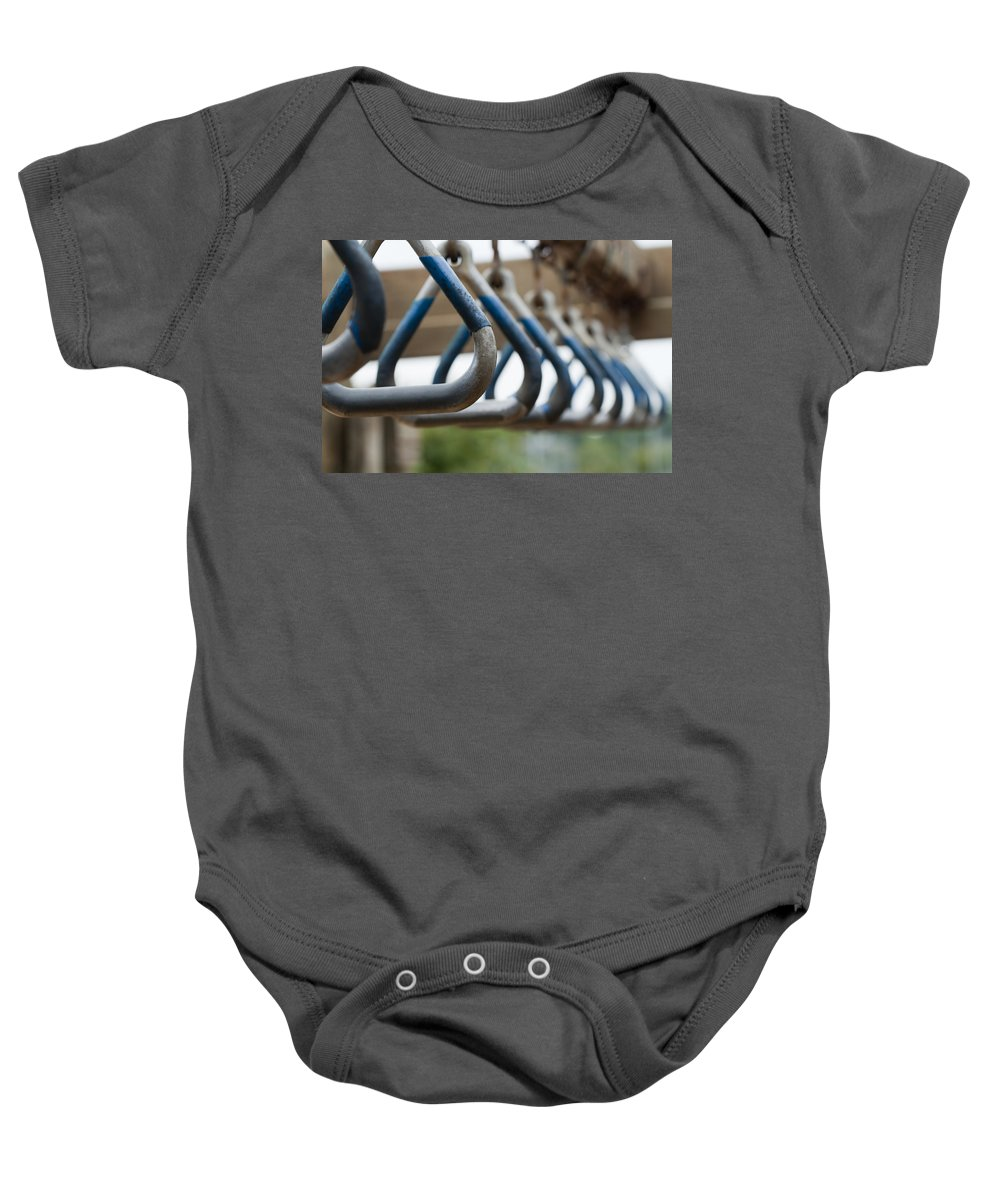 Playground Equipment Baby Onesie featuring the photograph Hang In There by Kathy Clark