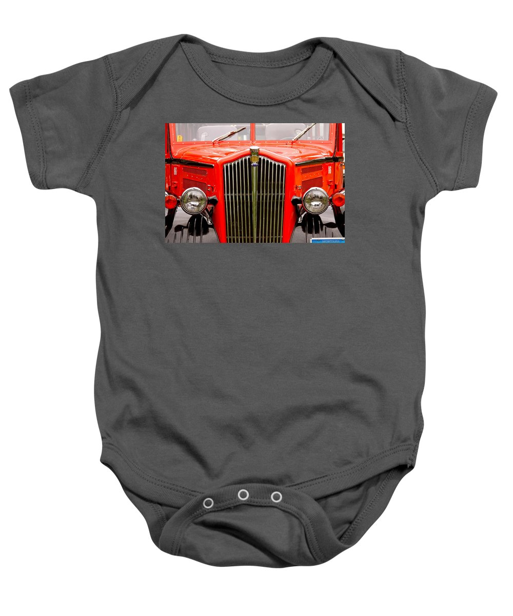 Red Baby Onesie featuring the photograph Historic Red Jammer Bus Glacier National Park by Karon Melillo DeVega