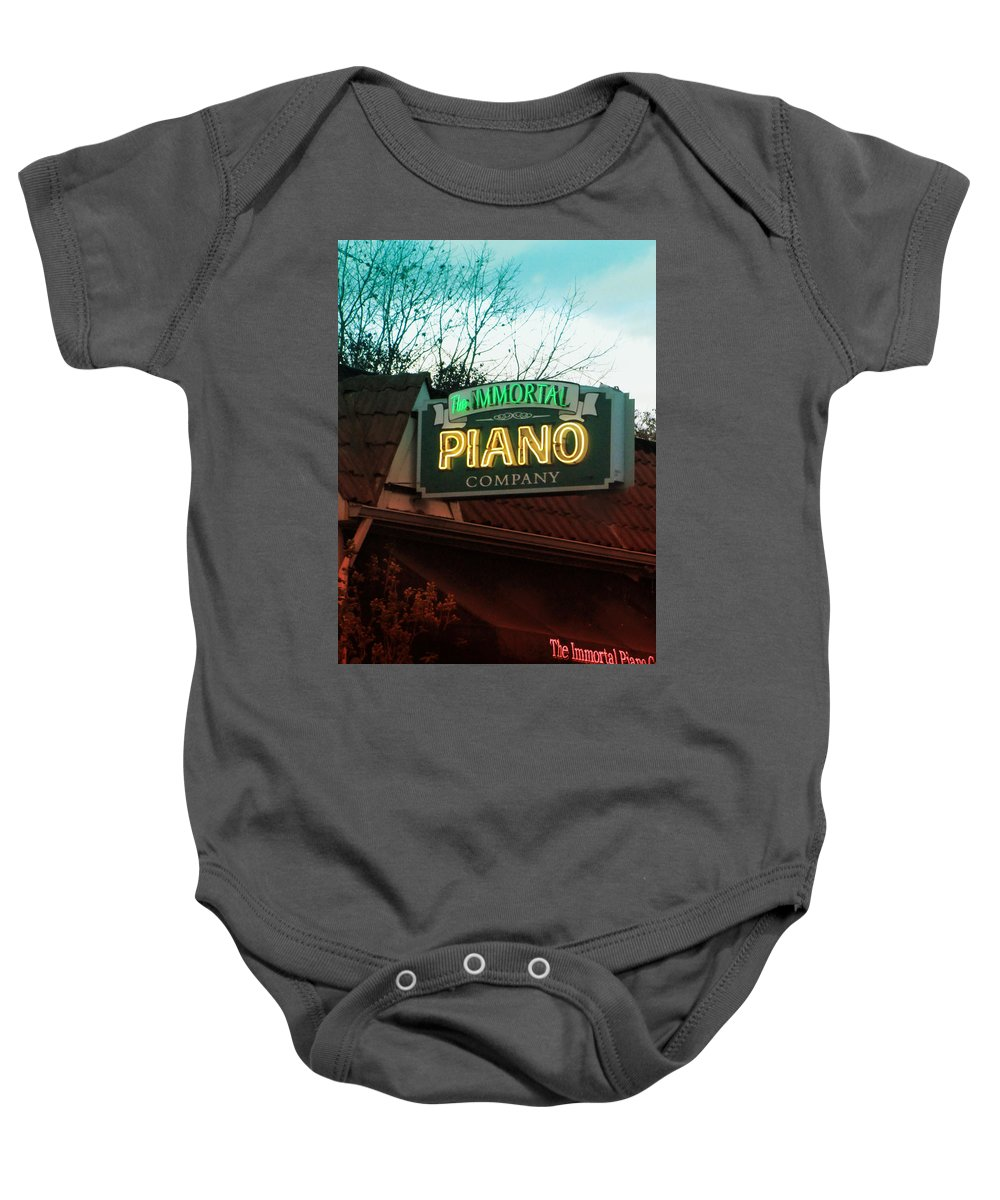 Signs Baby Onesie featuring the photograph Immortal Piano Co by Kathleen Grace