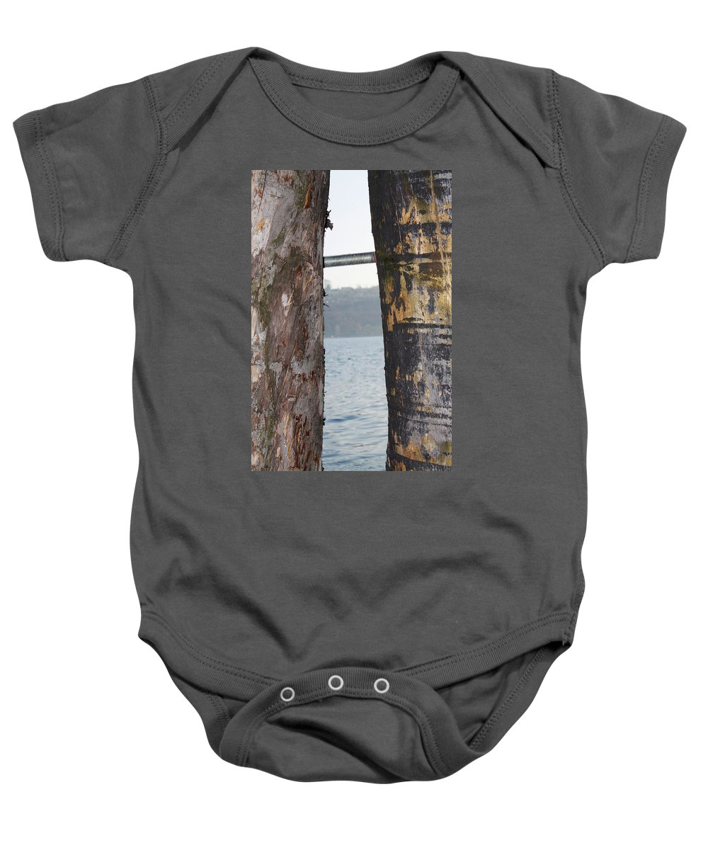 Lake Garda Baby Onesie featuring the photograph In Between by Donato Iannuzzi