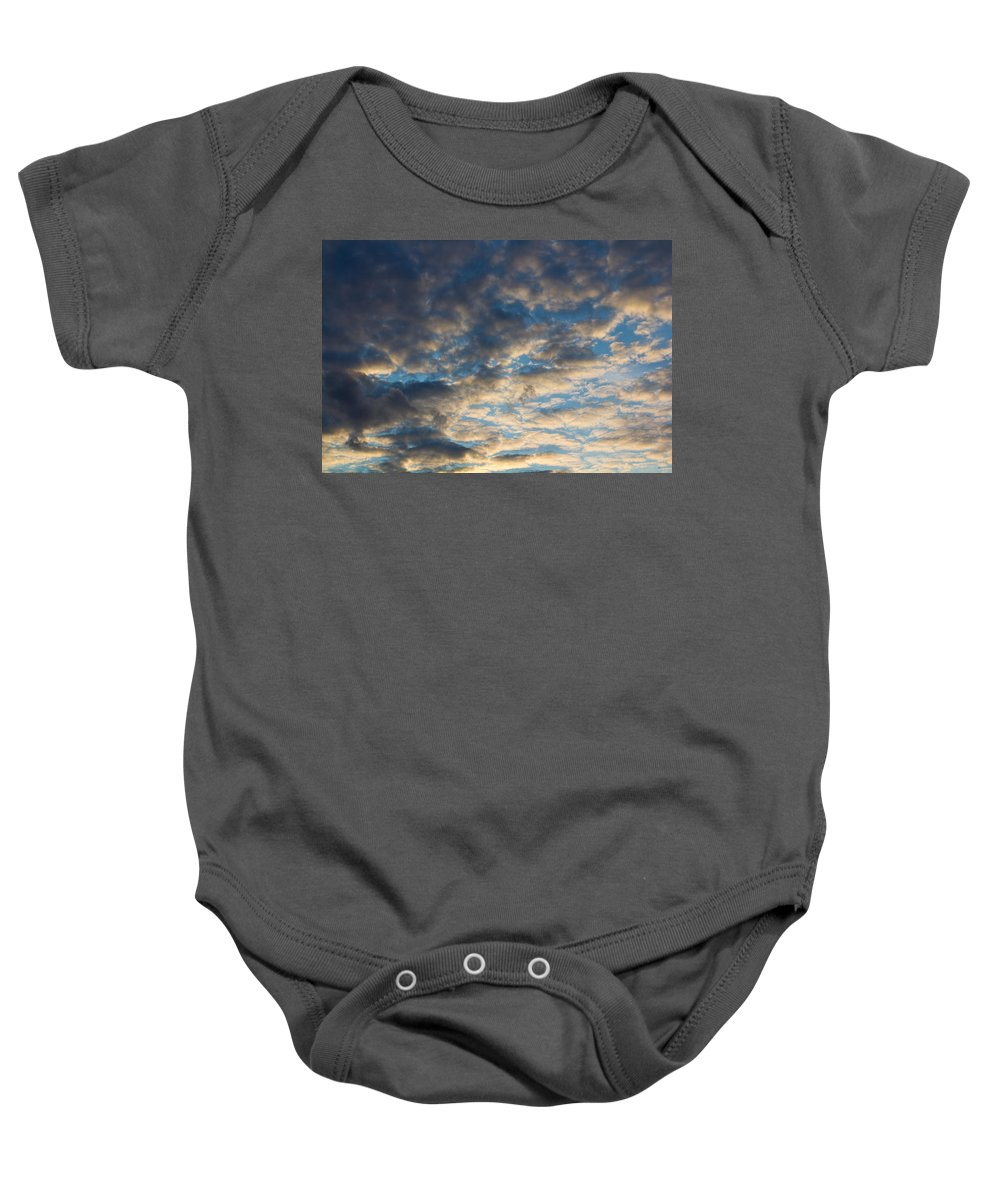 Clouds Baby Onesie featuring the photograph In The Clouds by David Pyatt