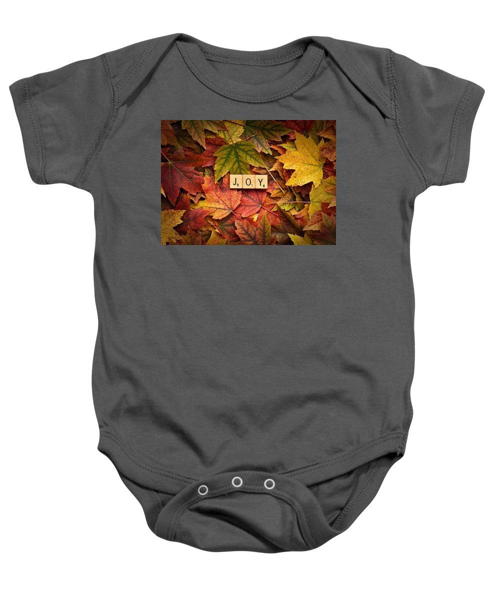 Daniel J. Kmiecik Baby Onesie featuring the photograph Joy-autumn by Onyonet Photo Studios