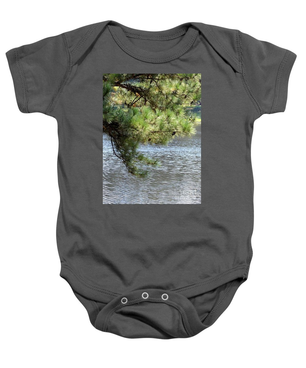 Lakeside Baby Onesie featuring the photograph Lakeside Pines by Maria Urso