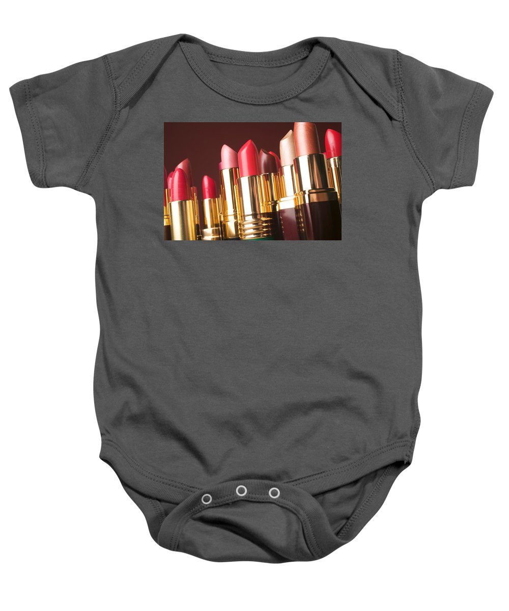 Lipstick Baby Onesie featuring the photograph Lipstick Tubes by Garry Gay