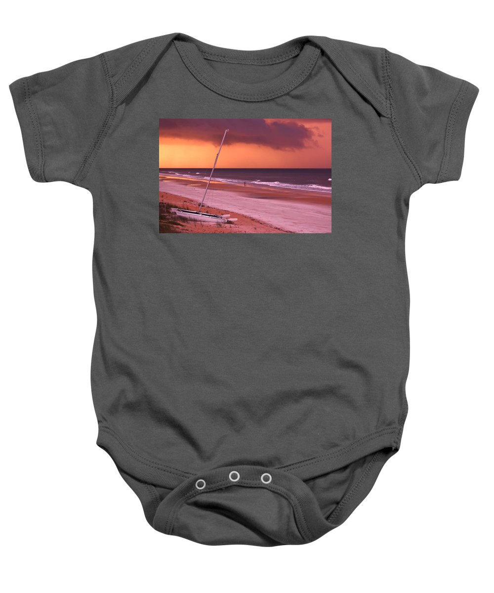 Beach Baby Onesie featuring the photograph Lovers Embrace On The Shoreline by DigiArt Diaries by Vicky B Fuller