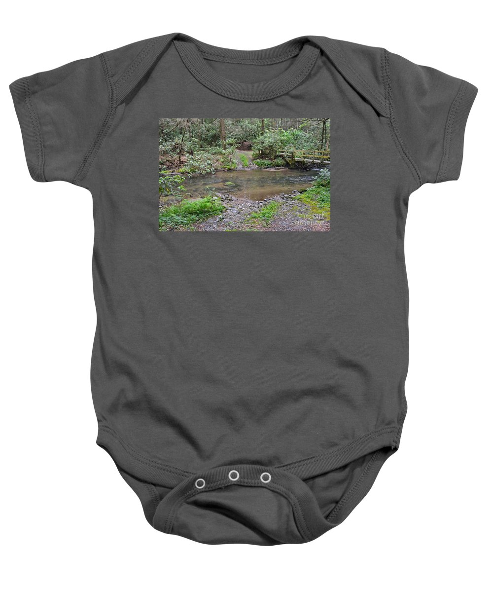 Stream Baby Onesie featuring the photograph Mountain Road And Footbridge by Carol Bradley