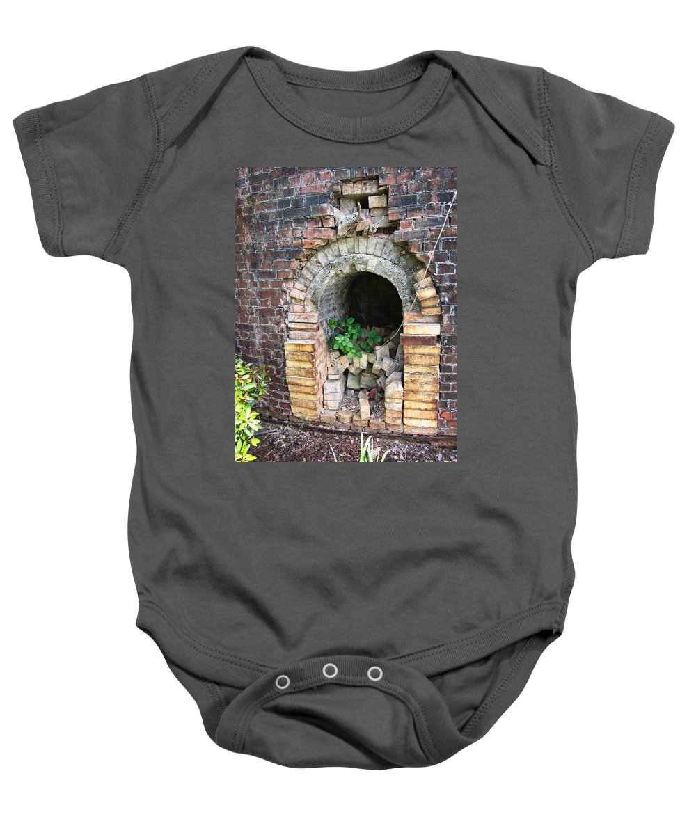 Brick Kiln Baby Onesie featuring the photograph Old Antique Brick Kiln Fire Box by Kathy Clark