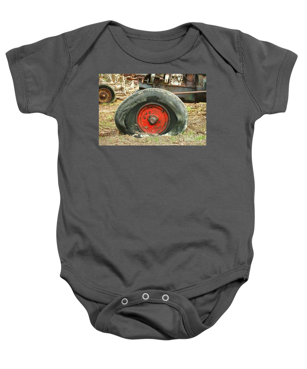 Wheel Baby Onesie featuring the photograph Only Flat On The Bottom by Stephen Mitchell