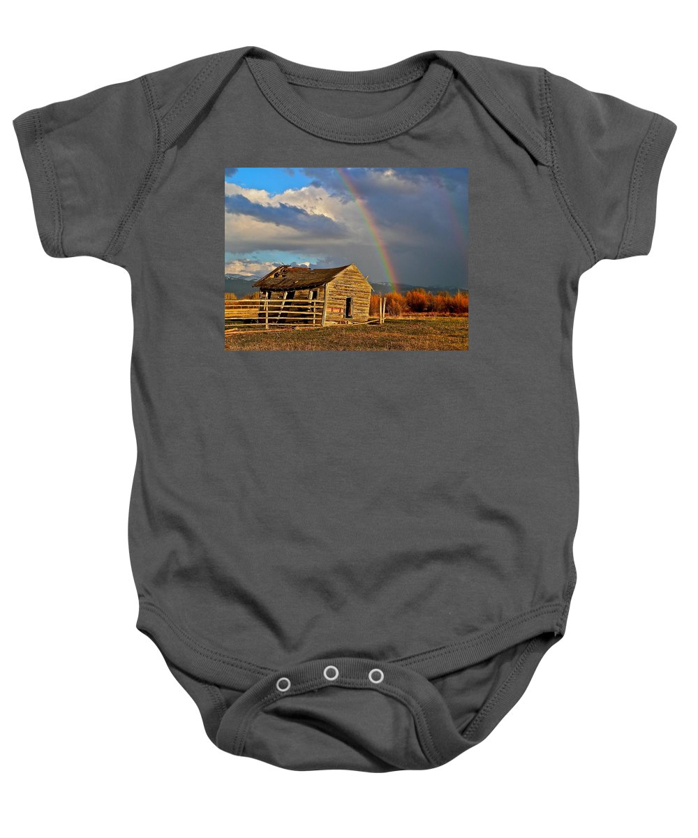Teton Valley Baby Onesie featuring the photograph Rainbow's End by Eric Tressler