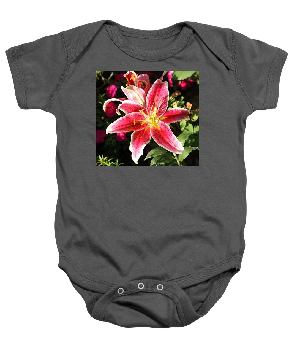 Colorado Baby Onesie featuring the photograph Red And White Tiger Lily by Kimberlee Fiedler