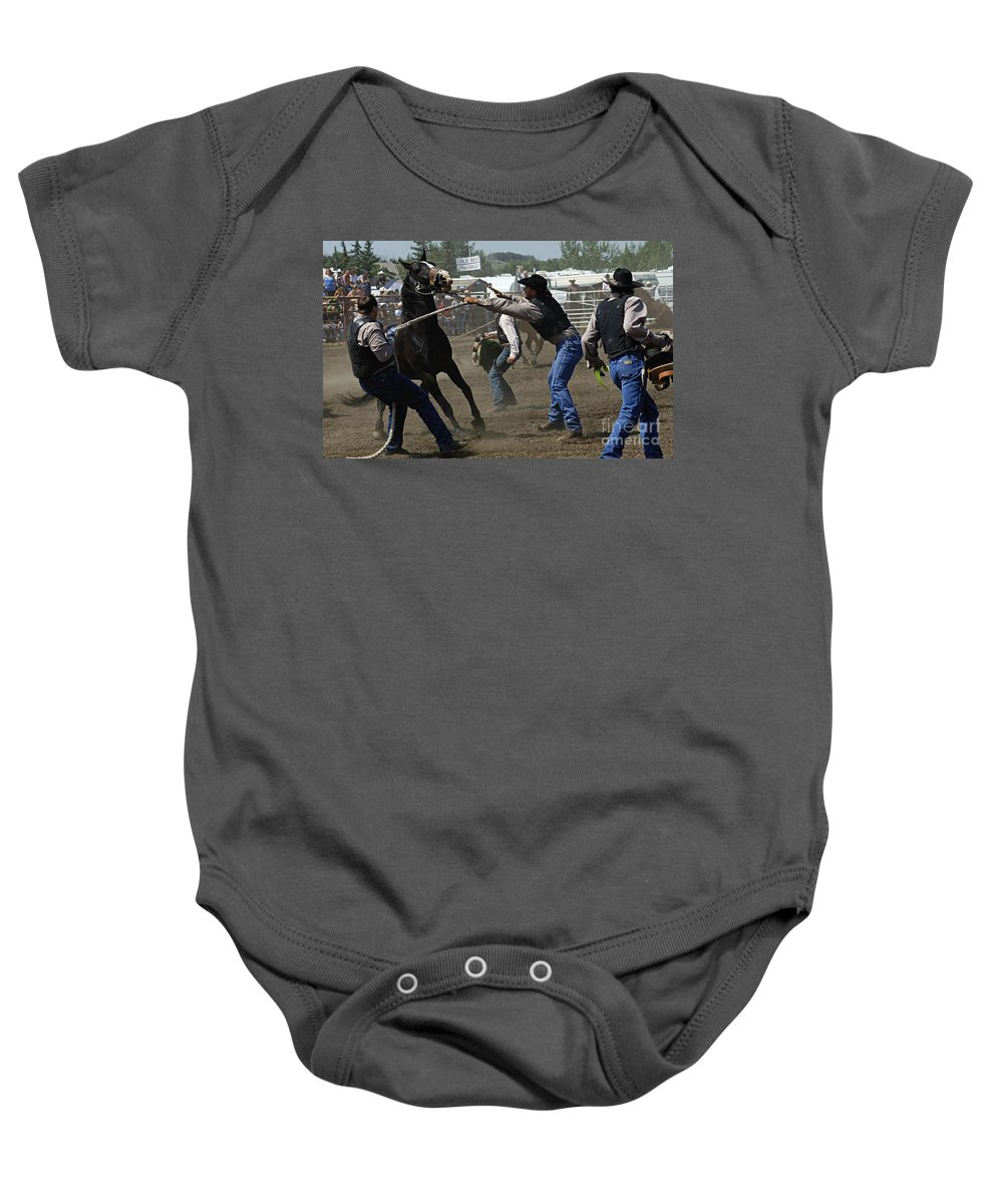 Rodeo Baby Onesie featuring the photograph Rodeo Wild Horse Race by Bob Christopher