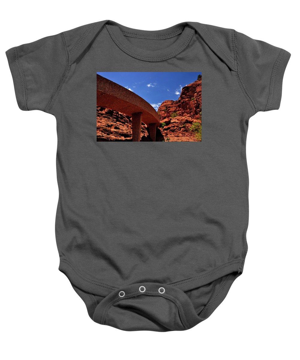 Sedona Man Vs Rock Contrast Baby Onesie featuring the photograph Sedona Man Vs Rock Contrast by Mark Valentine