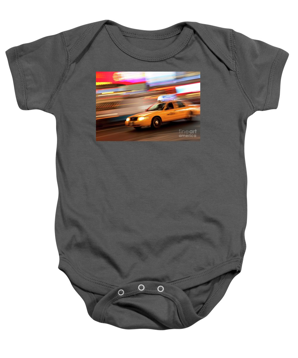 Speed Baby Onesie featuring the photograph Speeding Cab by Brian Jannsen