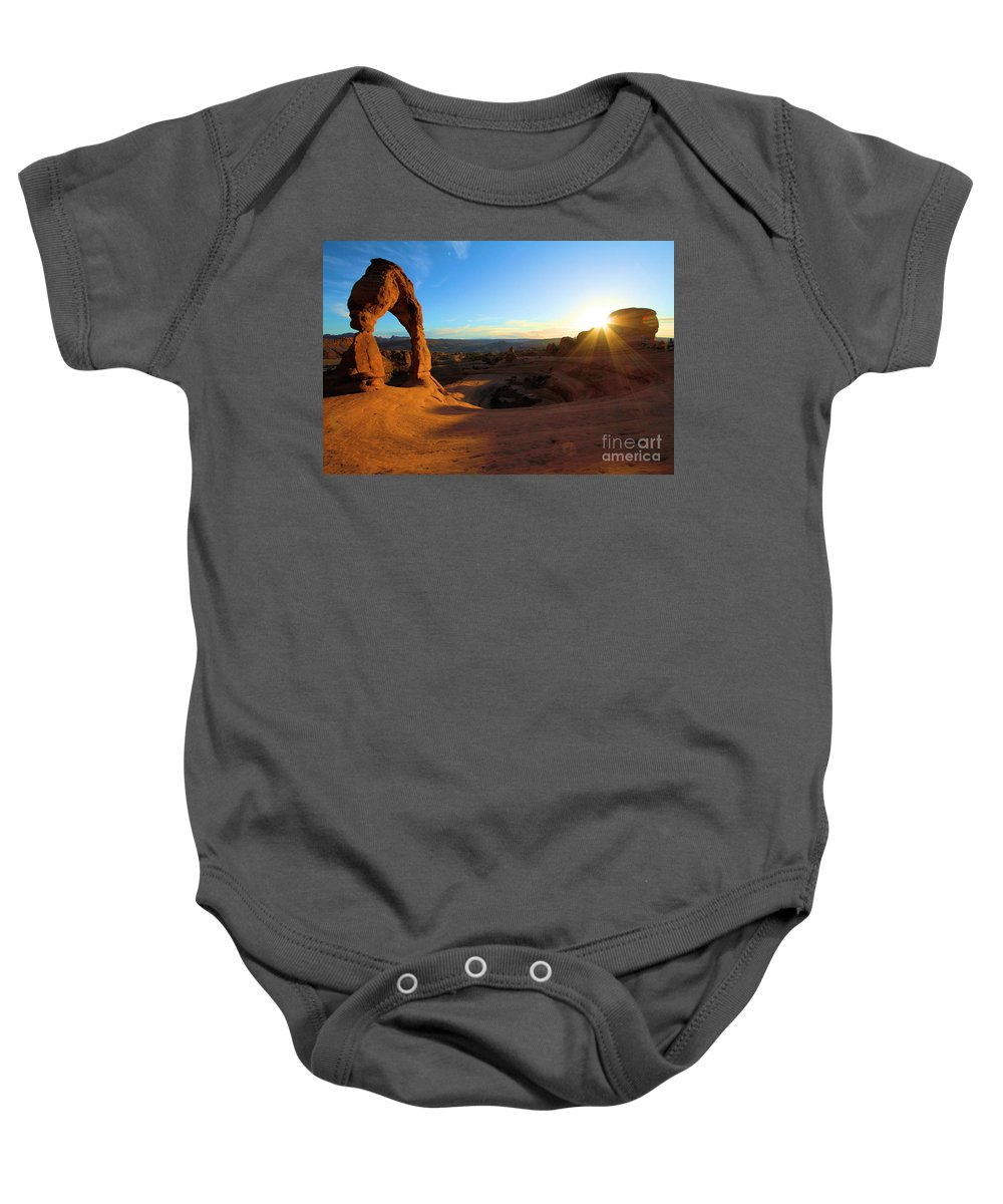 Delicate Arch Baby Onesie featuring the photograph Starburst At Delicate Arch by Adam Jewell