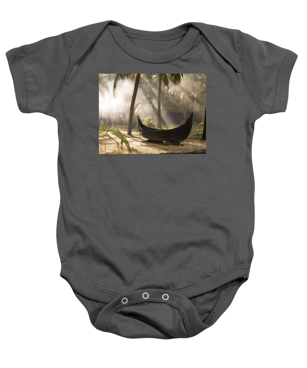Activity Baby Onesie featuring the photograph Sunlight Shining On A Canoe by Keith Levit