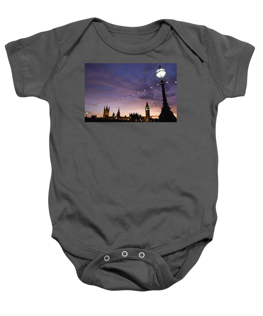 Architecture Baby Onesie featuring the photograph Sunset Behind Big Ben And The Houses by Axiom Photographic