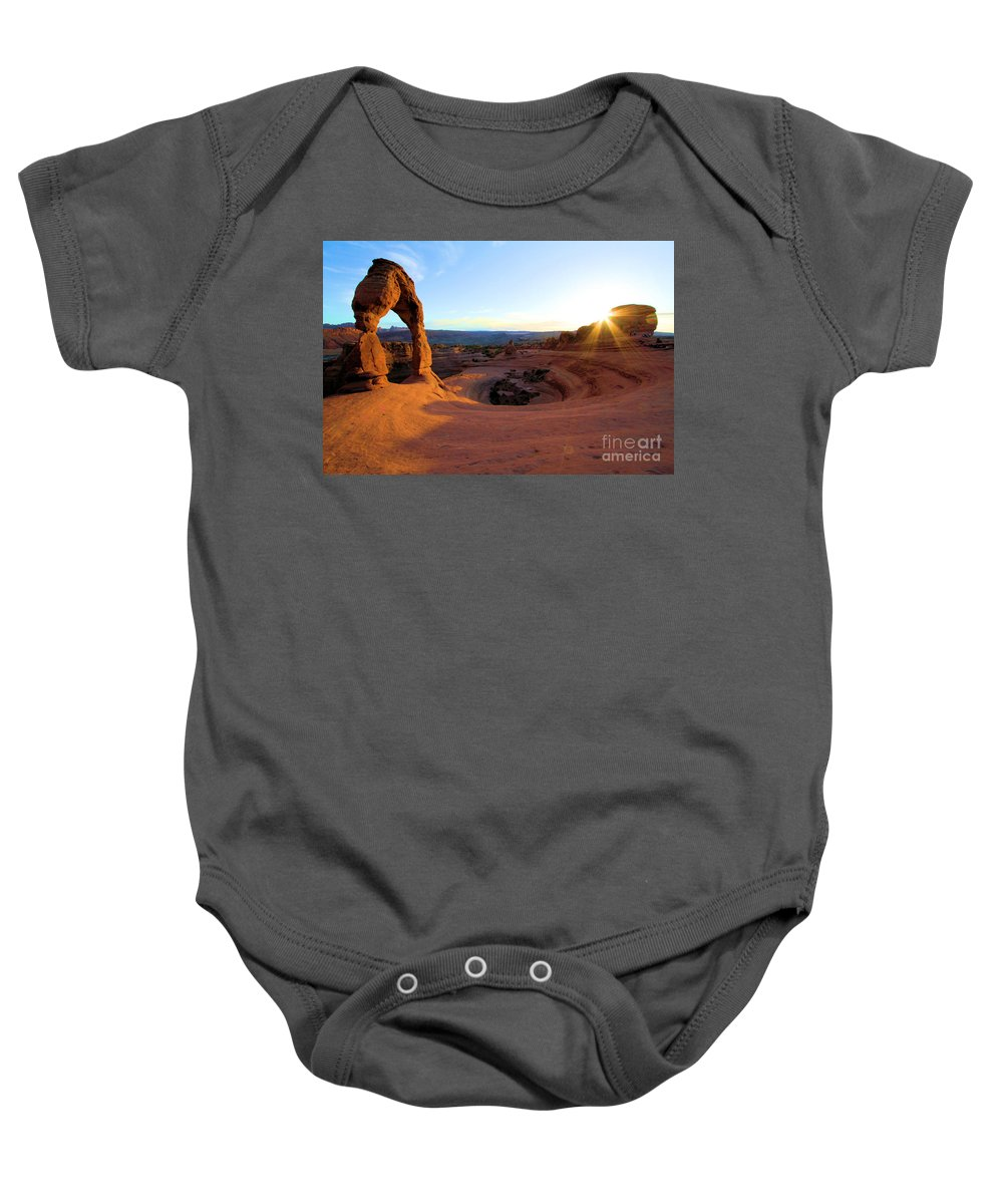 Delicate Arch Baby Onesie featuring the photograph Sunset Starburst by Adam Jewell