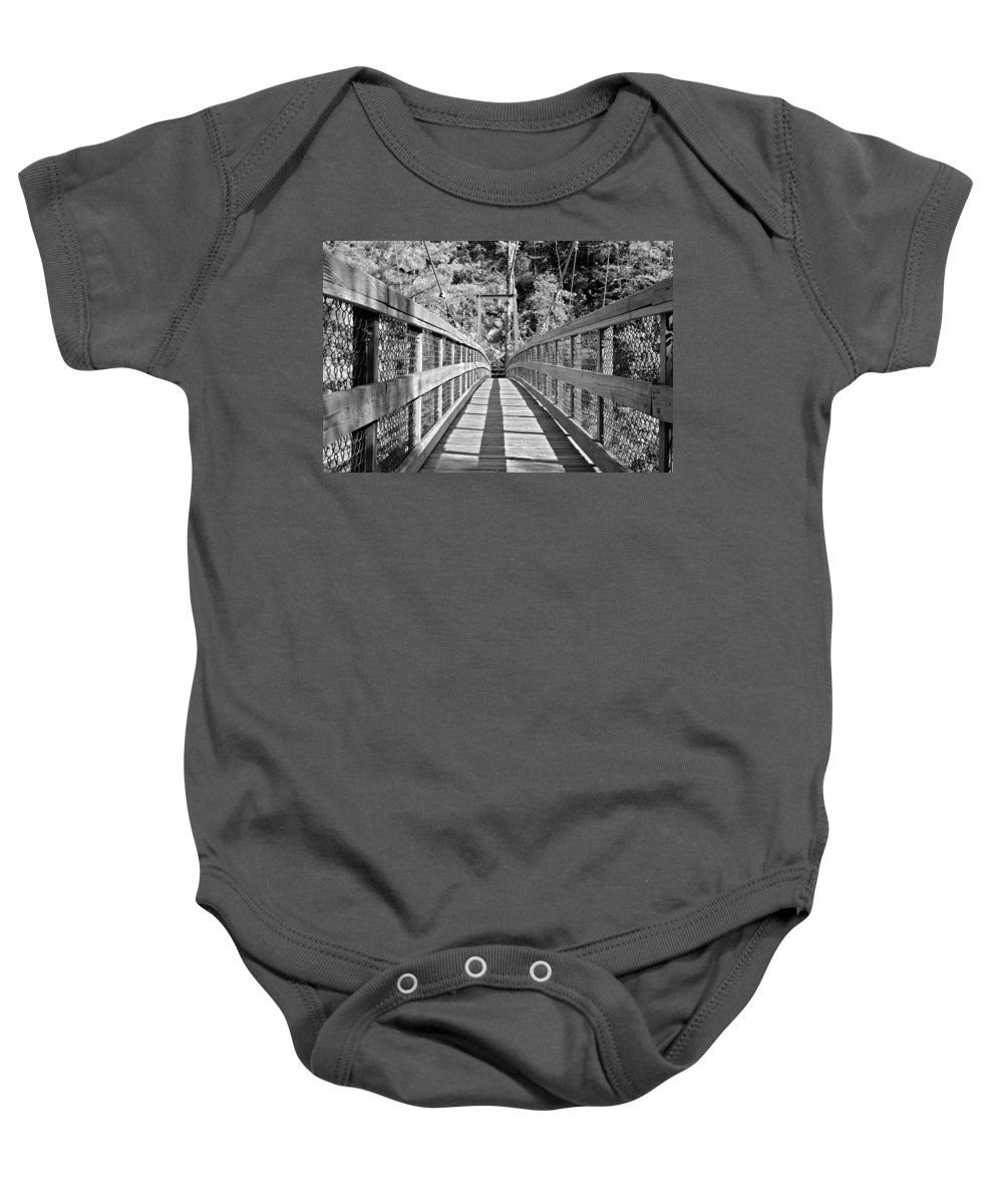 Bridge Baby Onesie featuring the photograph Suspension Bridge by Susan Leggett