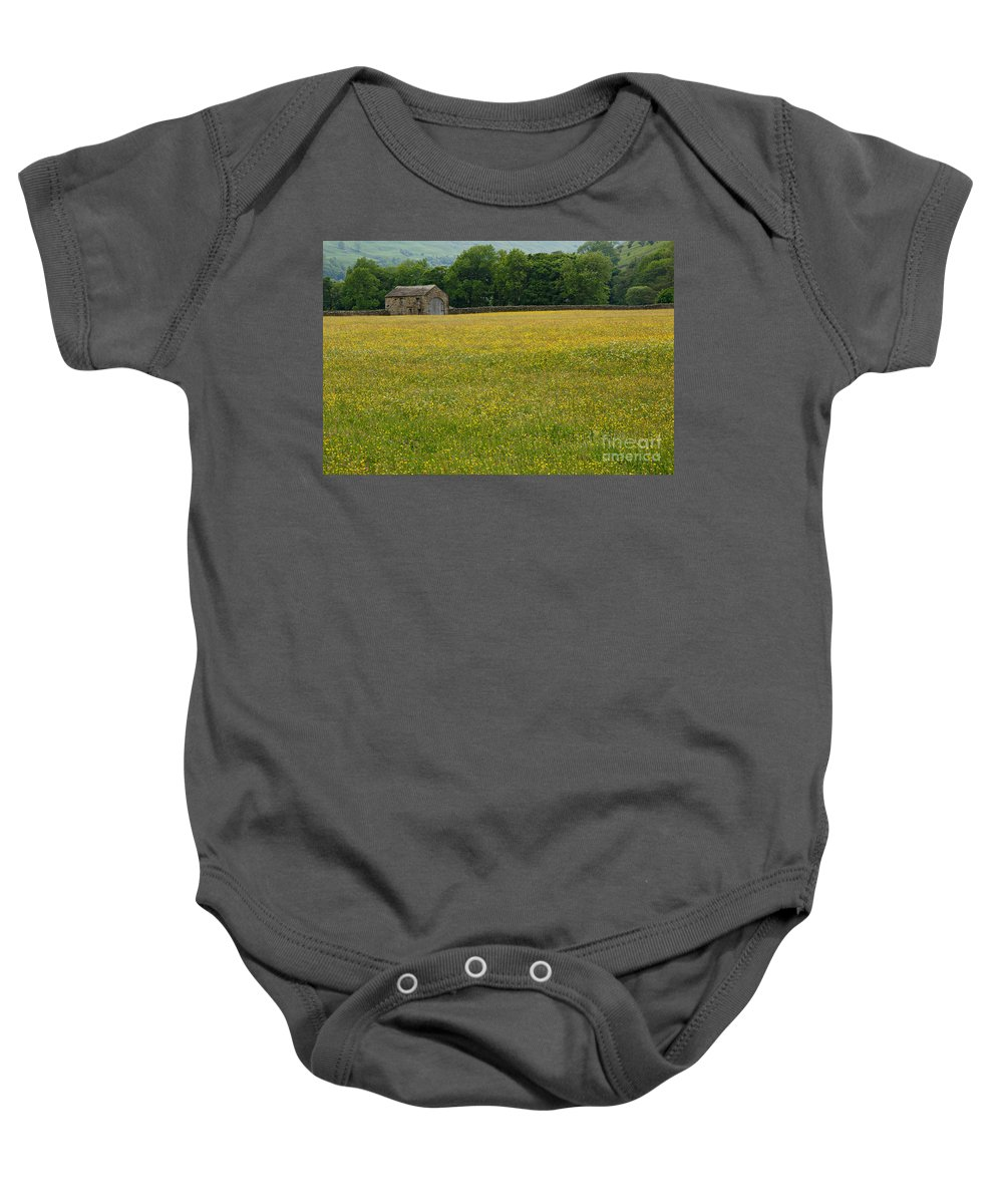 Field Baby Onesie featuring the photograph Swaledale Buttercup Meadow by Louise Heusinkveld