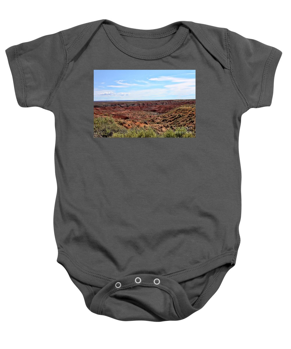 The Painted Desert Baby Onesie featuring the photograph The Painted Desert by Tommy Anderson