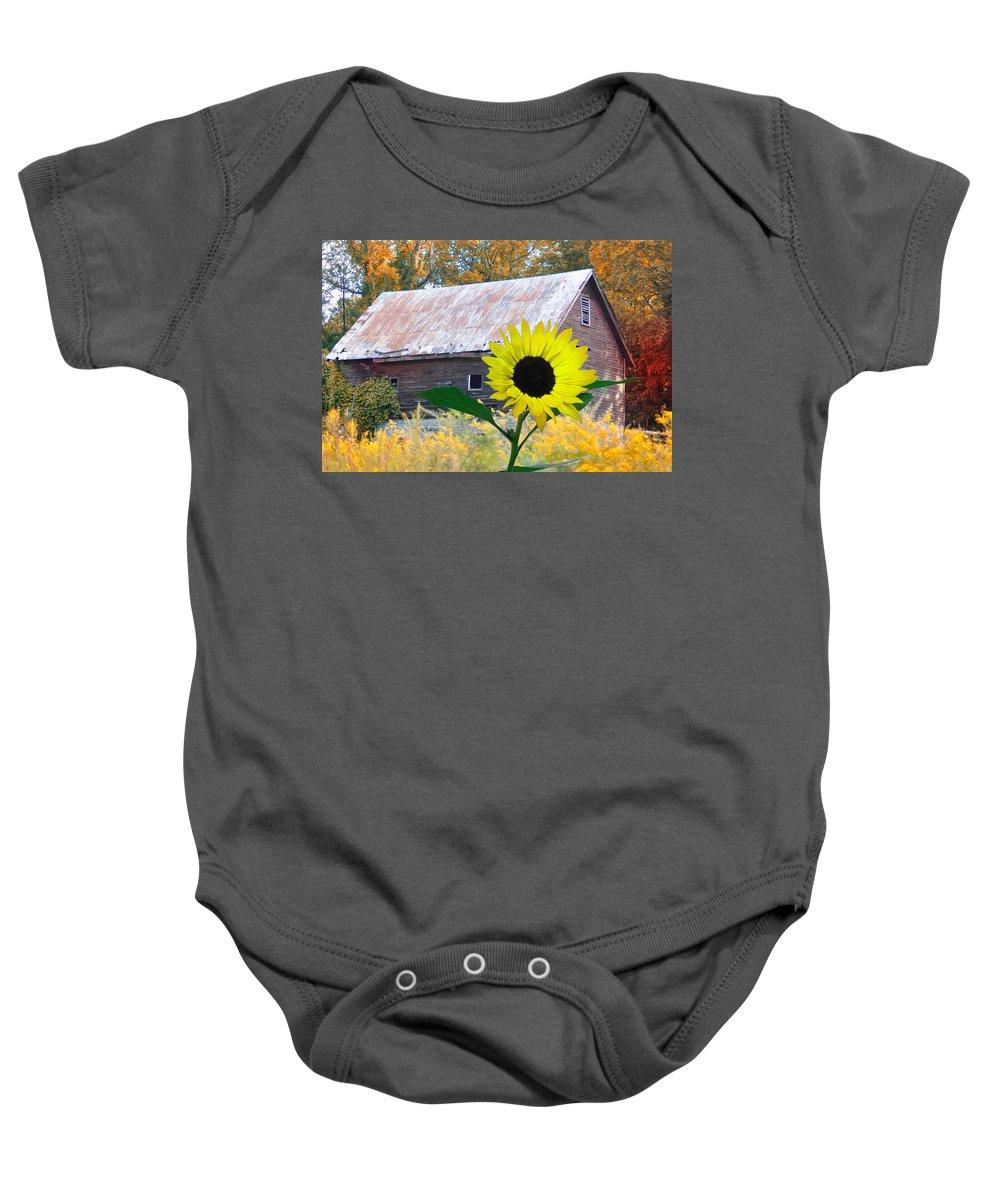 Sunflower Baby Onesie featuring the photograph The Sunflower And The Barn by Bill Cannon