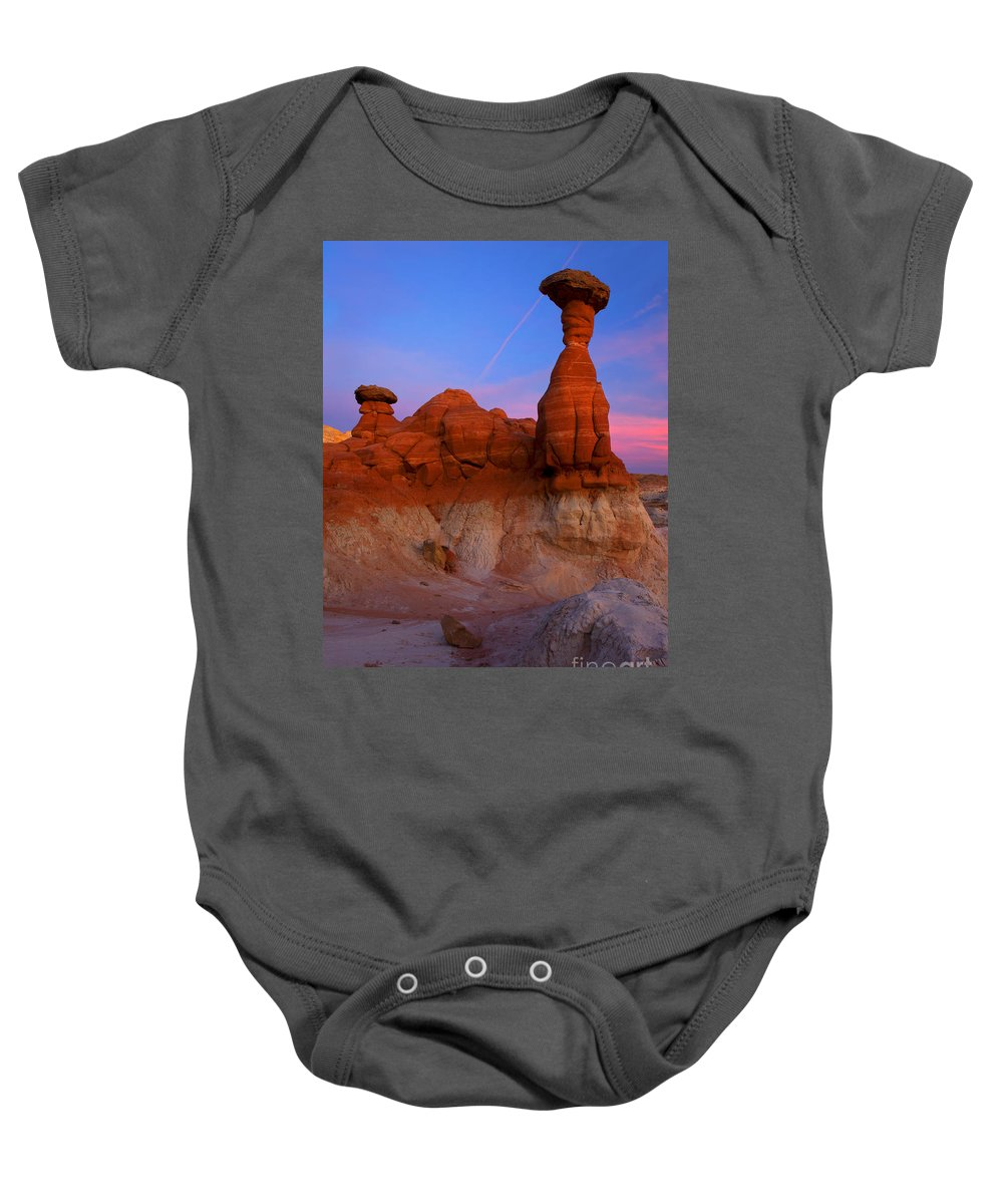 Toadstool Rock Baby Onesie featuring the photograph Toadstool Dusk by Mike Dawson