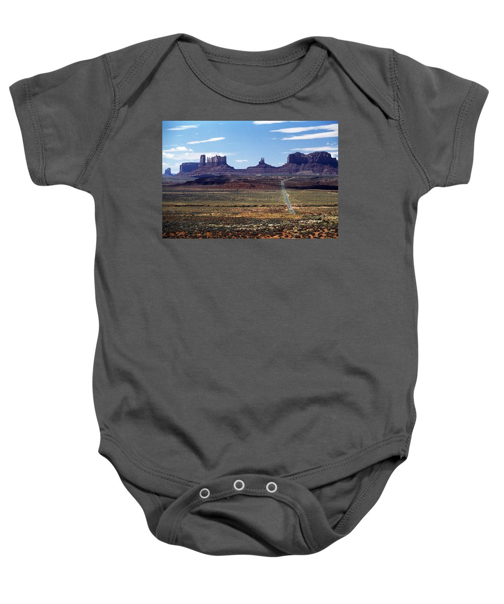 Barren Baby Onesie featuring the photograph Utah, Usa Highway And Rock Formations by John Doornkamp