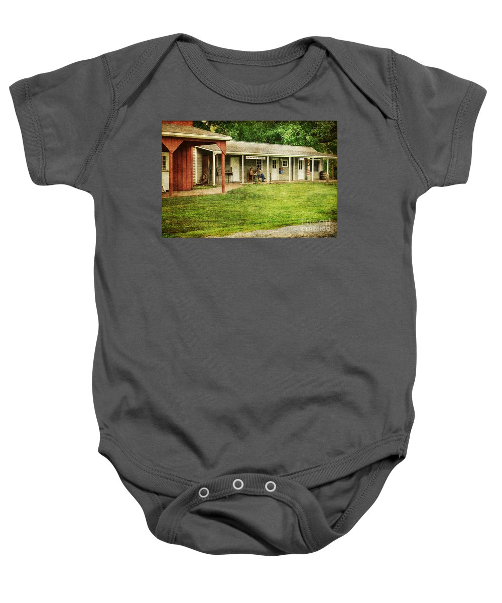 Waiting By The General Store Baby Onesie featuring the photograph Waiting By The General Store by Paul Ward