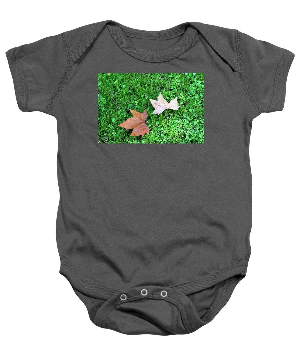 Wet Leaves Baby Onesie featuring the photograph Wet Leaves On Grass by Lorraine Devon Wilke